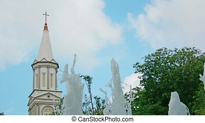 Tower of Cathedral of the Good Shepherd and a fountain. Singapore.