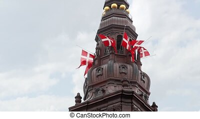 Christiansborg Slot with sculptures and fluttering flags -...