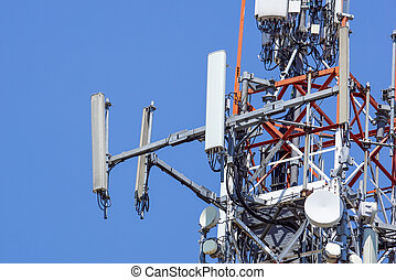 tower of communications with with a lot of different antennas under clear sky.