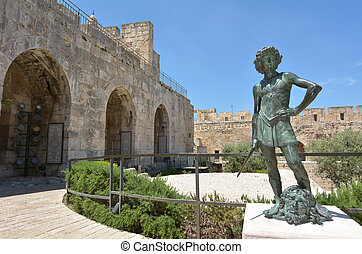 JERUSALEM - MAY 05 2015:David and Goliath sculpture at the Tower of David and archeological garden in Jerusalem, Israel. It's a famous landmark of Jerusalem with historical significant.