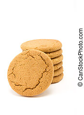 Tower of Ginger Snap Biscuits from low viewpoint isolated against white background.
