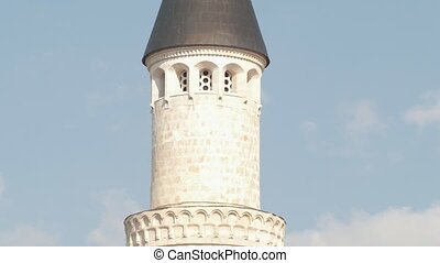 Tower of islamic Muslim mosque - pan shot, close up