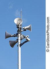 Tower of loudspeaker against clear blue sky
