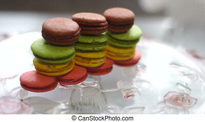 Tower of macaroon cookies falls on the plate