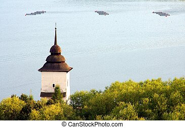 Tower of old church by the lake