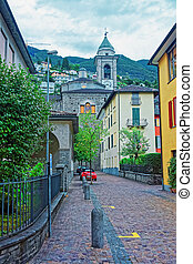 Locarno, Switzerland - August 25, 2013: Tower of Church of Saint Antonio Abate in the city center of luxurious resort Locarno of Ticino canton, Switzerland.