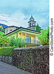 Tower of Church of San Antonio Abate in the city center of luxurious resort Locarno of Ticino canton, Switzerland.