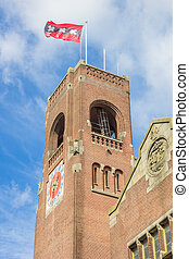 Tower of the Berlage building and flag in Amsterdam