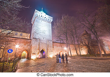 tower of the city fortification in old town at night, krakow, poland