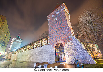 tower of the city fortification in old town at night,krakow,poland
