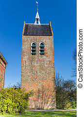 Tower of the historic church in Baflo