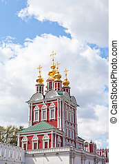 Tower of the Novodevichy Convent in Moscow on a background of blue sky