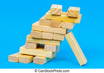 Tower of wooden blocks with risk concept