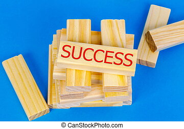 Tower of wooden blocks with success concept