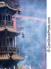 tower shape incense burner in a temple