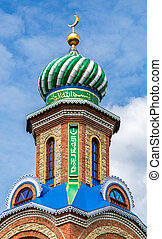 Tower with dome of islamic mosque against the sky