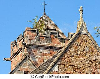Tower with gargoyles on Baptist Church in Lea Marston, UK.