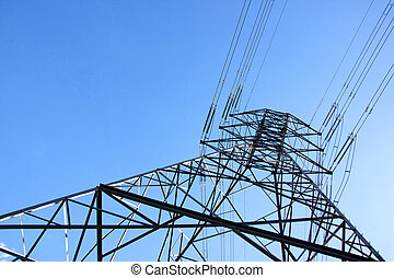closeup underview of towering steel pylon supporting electric power cables