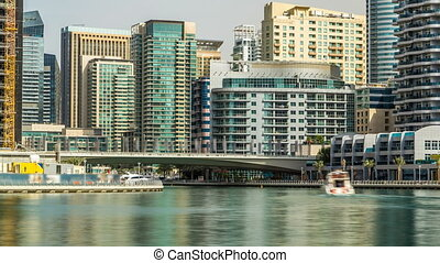 Towers and bridge in Dubai Marina timelapse, UAE.