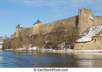 Towers and walls of the ancient Ivangorod fortress above the border river Narva. Leningrad region, Russia