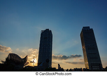 Towers back light at dusk in Barcelona - Wide angle of...