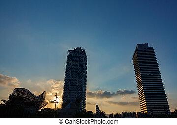 Towers back light at dusk in Barcelona