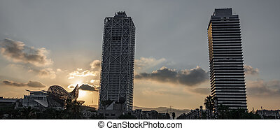 Towers back light at sunset in Barcelona - Wide angle of...