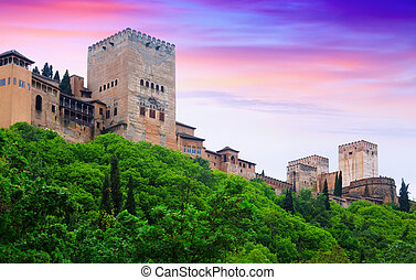 Towers of Alcazaba at Alhambra in sunset. Granada, Spain