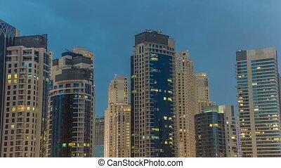 Towers of Dubai Marina in Dubai day to night timelapse