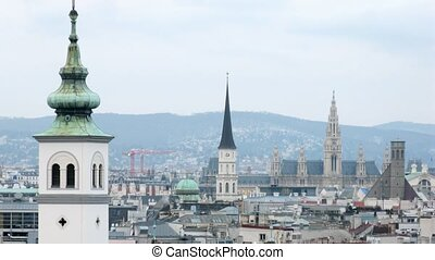 Towers of Rathaus dominate on city landscape, time lapse
