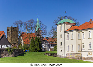 Towers of the castle and church in the Old Village of Westerholt