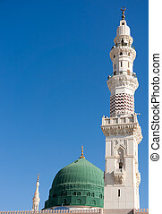 Towers of the Nabawi mosque againts blue sky. Nabawi mosque is Islam's second holiest mosque after Haram Mosque (in Mecca, Saudi Arabia)