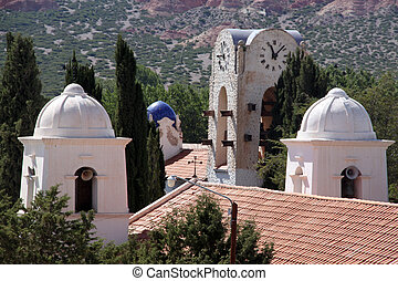 Towers - Tile roof and towers of church and clock in...