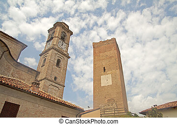 Two towers pointing towards the sky in Barbaresco, Italy