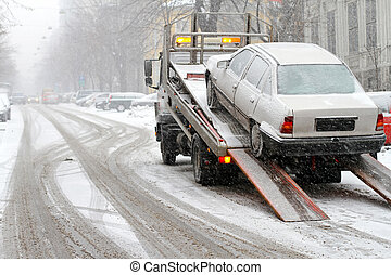 Towing car - Car break down and towing at snow street