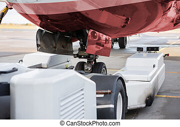 Towing Machine And Airplane On Runway