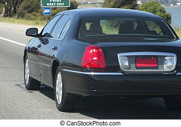 Town Car on Freeway