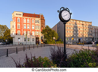 Town clock in central part of Gliwice during sunset.