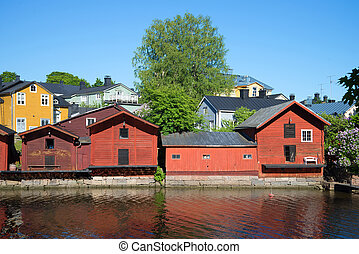 Town embankment with ancient port warehouses on the sunny June day. Porvoo, Finland