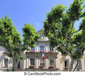 Town hall of Carpentras in France with French national flag