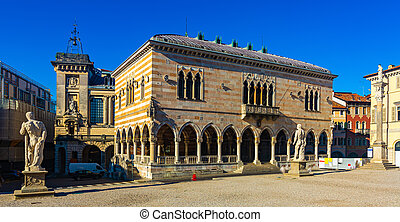 View of Gothic building of Loggia del Lionello - town hall of Udine on central city square of Piazza liberta in sunny day, Italy