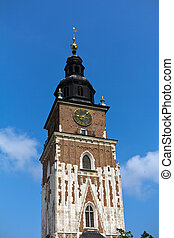 town hall tower on main market square in cracow in poland on blue sky background