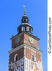 Town hall tower on main market square on blue sky background, Krakow, Poland