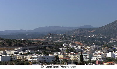 Town in the mountains panorama - Slow pan over the roofs of...