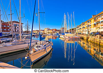 Town of Grado colorful waterfront and harbor view,...