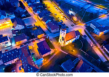 Town of Krizevci church and square aerial night view,...