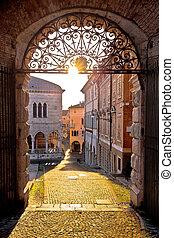 Town of Udine ancient gate aut sunset view, Piazza della Liberta square, Friuli-Venezia Giulia region of Italy