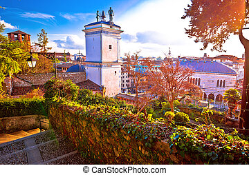 Town of Udine landmarks view with red sun haze,...