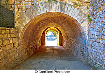 Town of Zadar historic stone street passage view