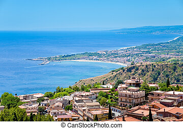 town Taormina and resort Gardini Naxos on Ionian coast -...